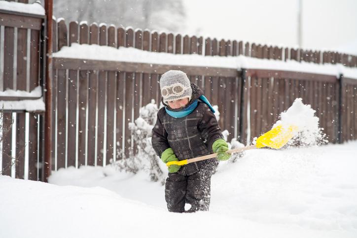 child shoveling